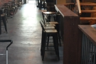 Further on, still on the left, there's a small bar with four, low-backed chairs.