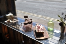... as well as a selection of cakes in the window.