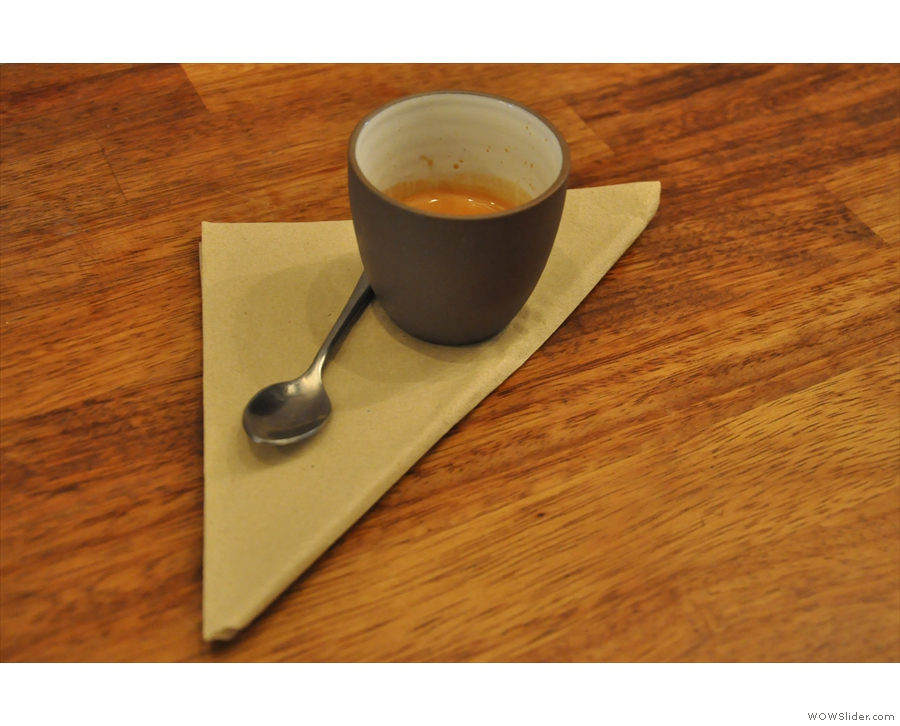 The guest espresso in a lovely handleless cup...