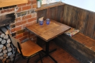 Finally, to the right, there's a large, open space behind the kitchen with tables like this one.