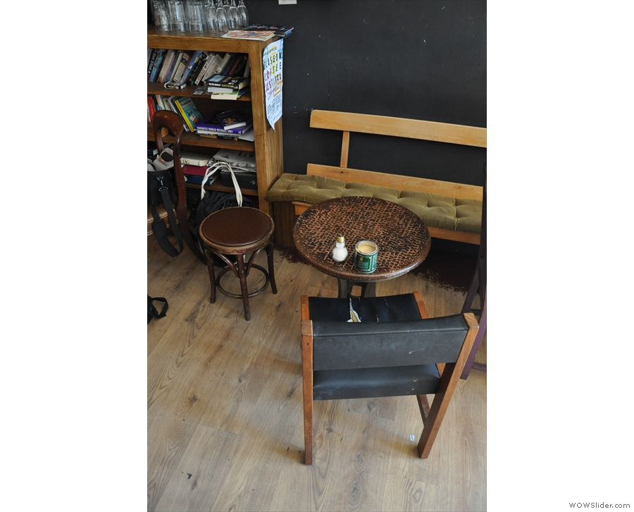 Alternatively, there are a pair of tables along a bench on the right-hand wall...