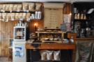 The coffee menu is at the front, along with a fridge and a workbench...