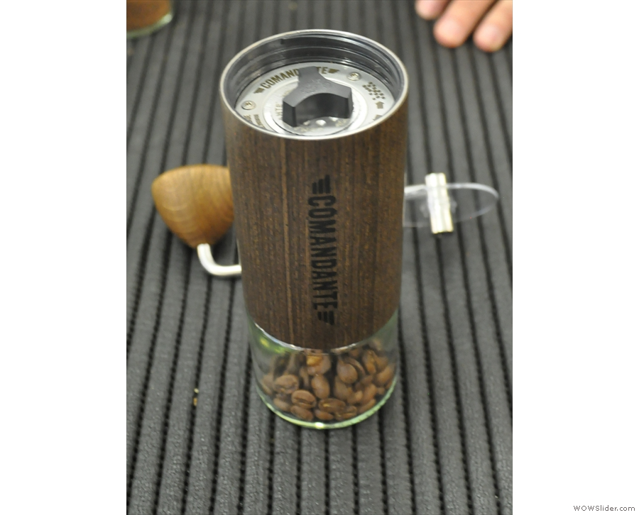 You put the beans in the hopper, then put the other part of the grinder on top.