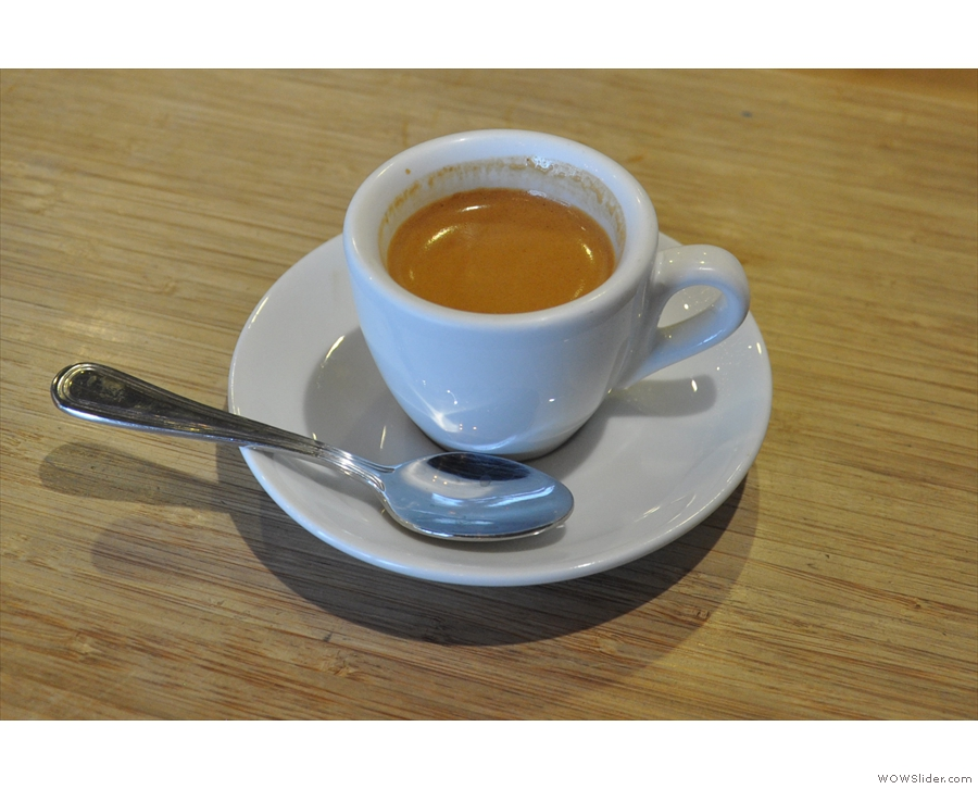 My espresso, bossing it in a classic white cup.