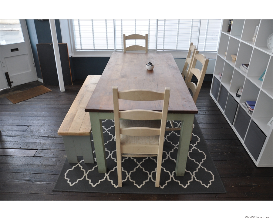 There's also this large, communal table immediately to the left of the door.