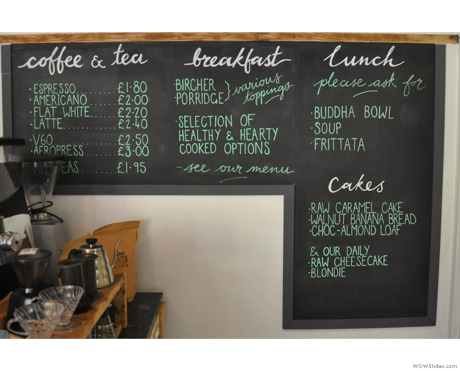 The concise menu is on the wall at the back...