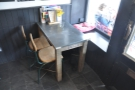 ... and this is to the right. You can sit on the windowsill or on one of the chairs...
