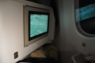 The TV is massive in business class. Mine's stowed out of the way, but press a button...