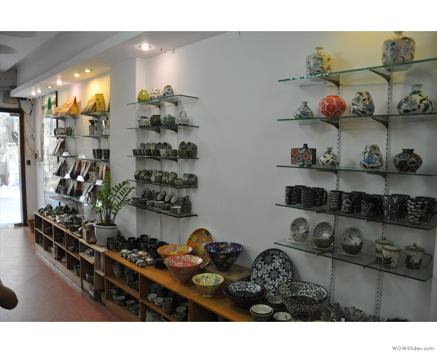 The shelves are packed with beautiful pottery.