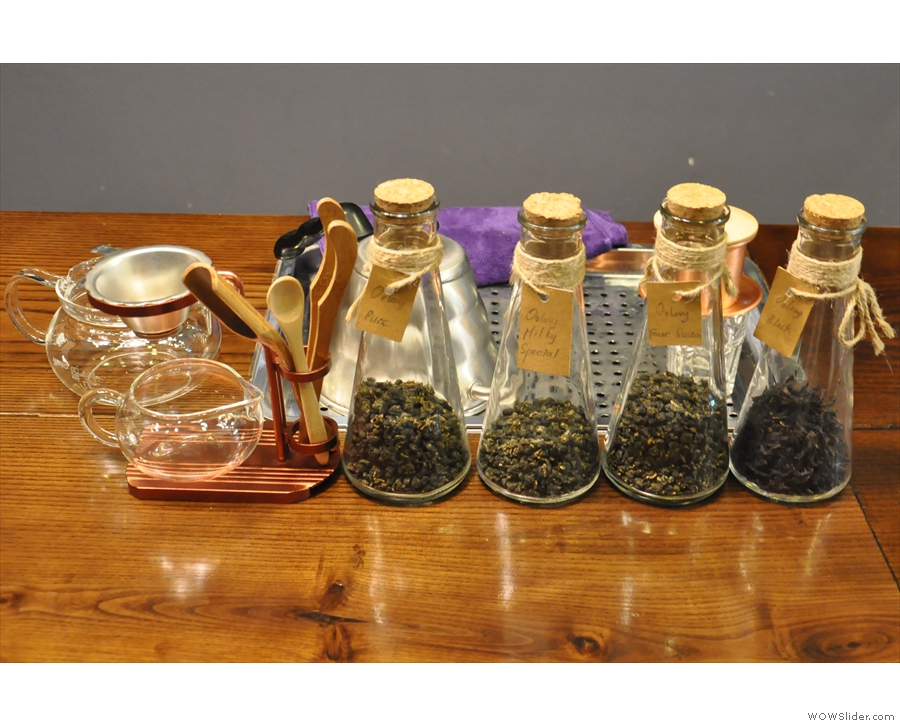 Some of the tea on offer, lined up in flasks on the counter.