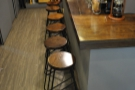 The only other downstairs seating is provided by these seven stools at the counter.