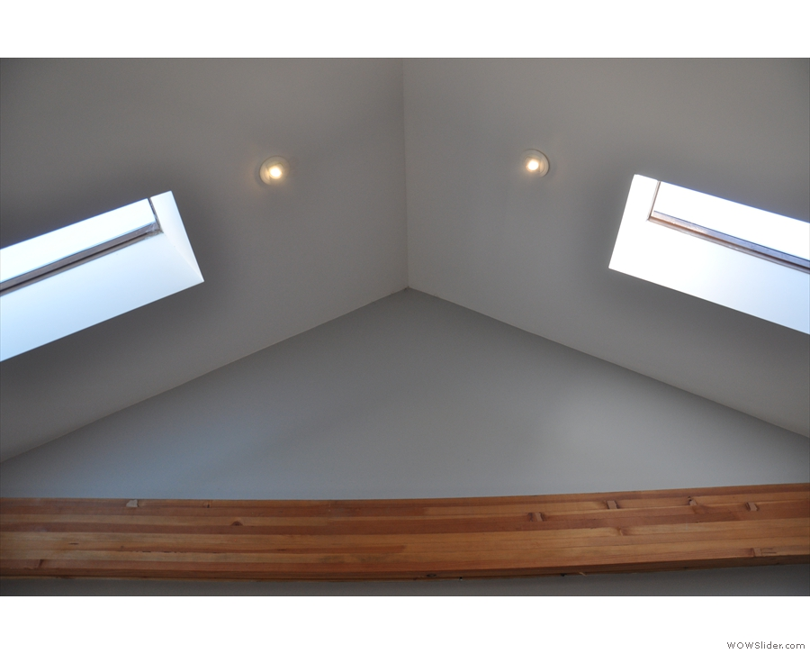 This is helped by the space being open to the A-framed roof and its multiple skylights.