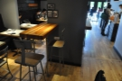 ... seen here from the other side, twin narrow tables projecting from a pillar.