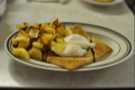 The breakfast of kings: two eggs, poached, wheat toast and home fries...