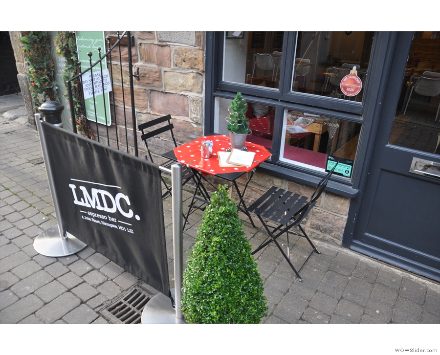 The quiet street makes for great outdoor seating, with a table to the left of the door...