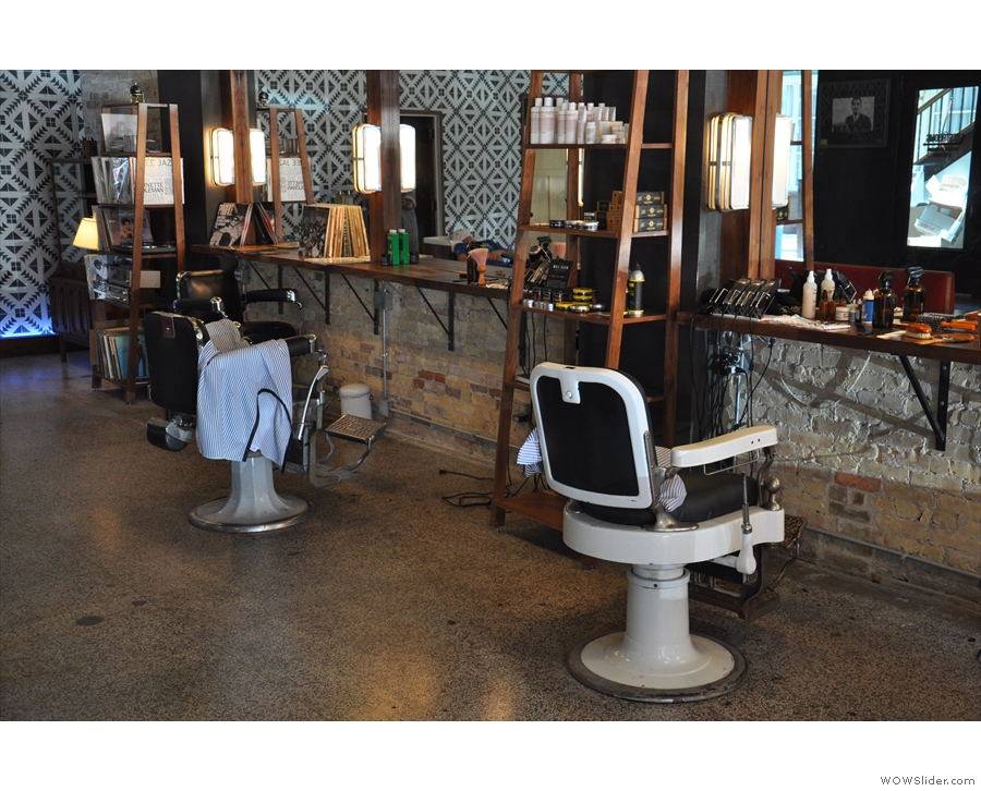 The barber's chairs line the right-hand wall, each with its own mirror.
