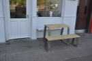 There's a neat little bench and table outside, which catches the morning sun.