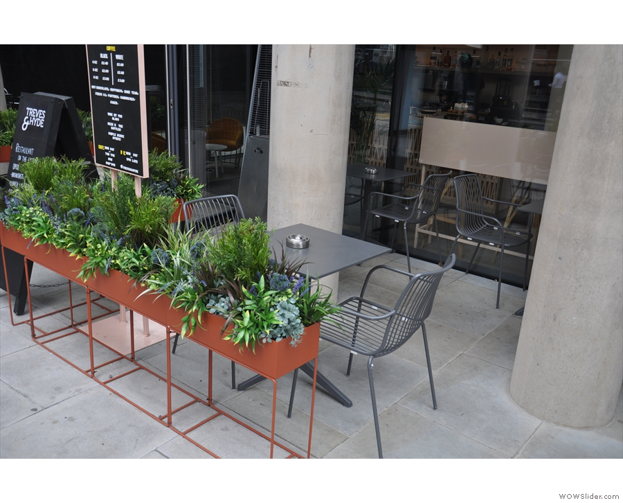 All those planters screen the outside seating area, which has plenty of tables...