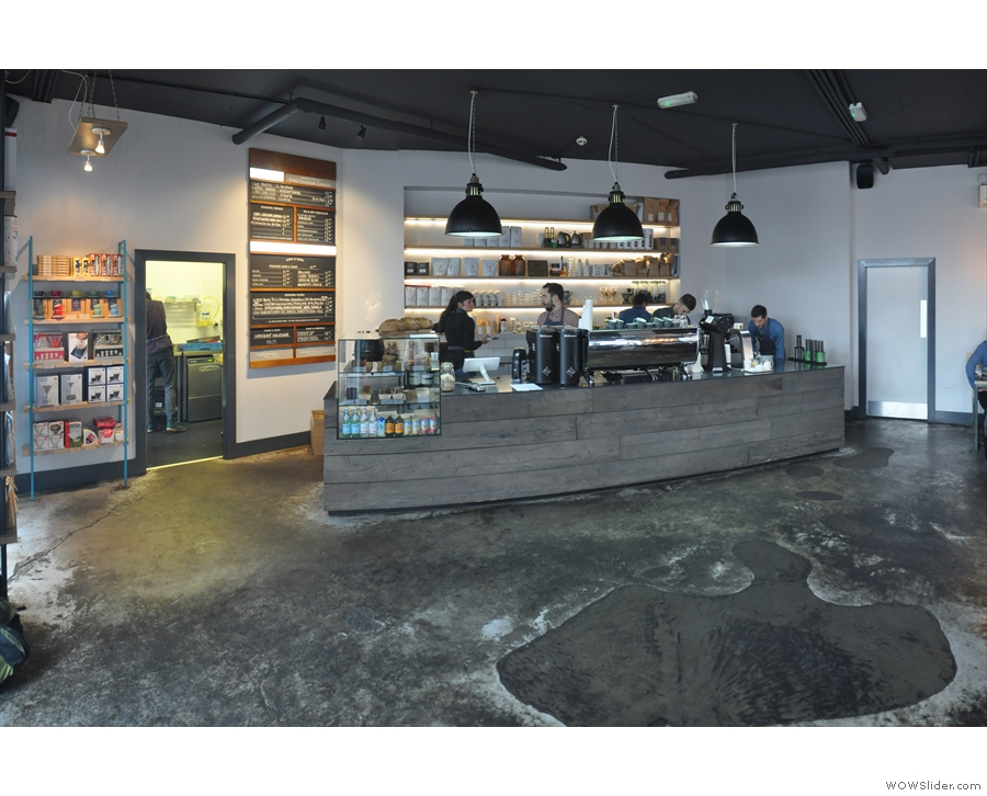 The counter is at one end, with plenty of space between it and the seating...