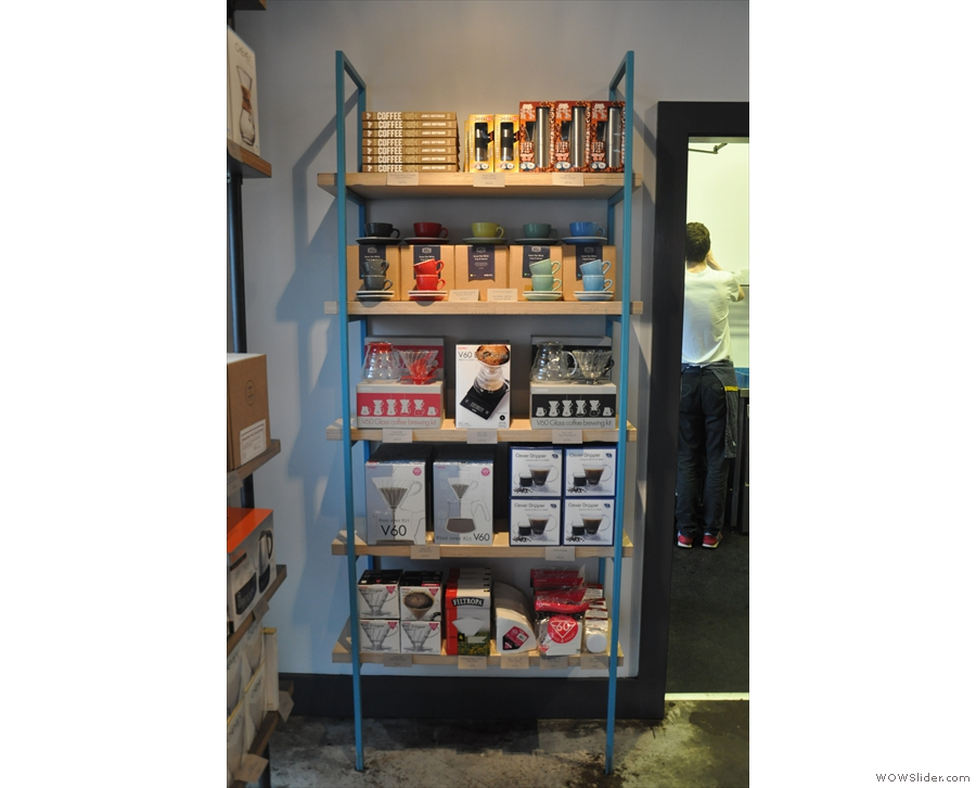 These shelves have the usual coffee-making and coffee-related kit...