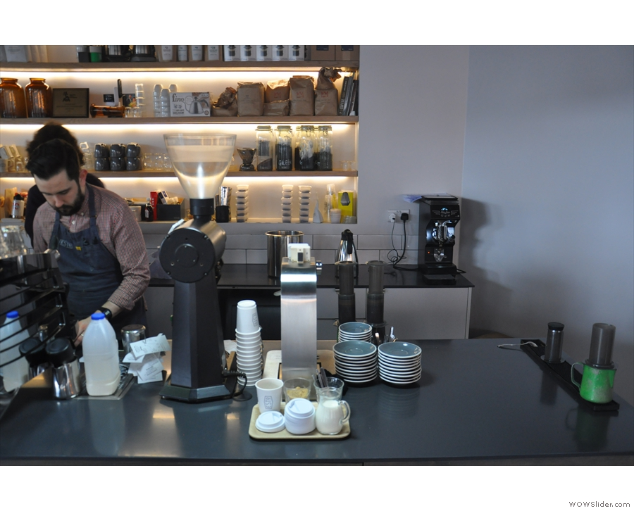 Filter coffee, mostly pour-over, is at the far end of the counter.
