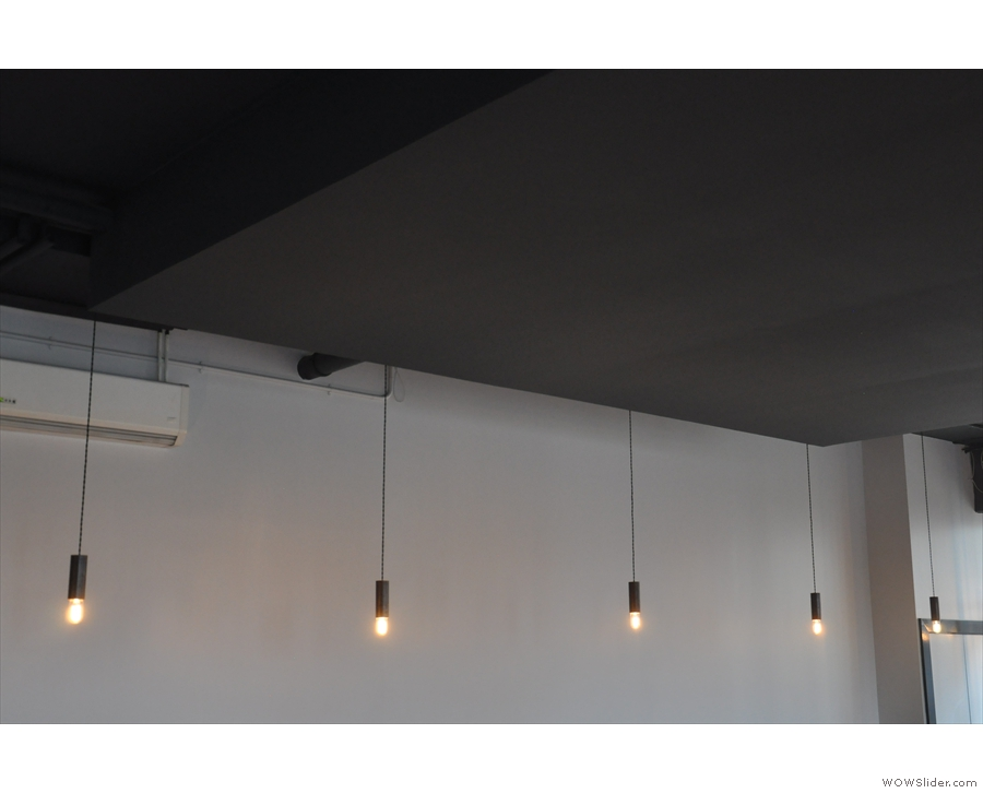 These hang above the tables lining the wall...