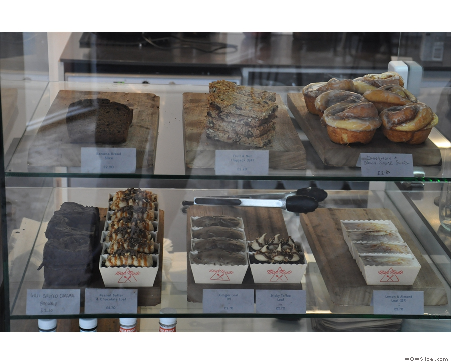 ... a range of tempting cakes, on display at the start of the counter.