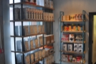 If you enter via the door towards the back, there's a set of retail shelves to your left.