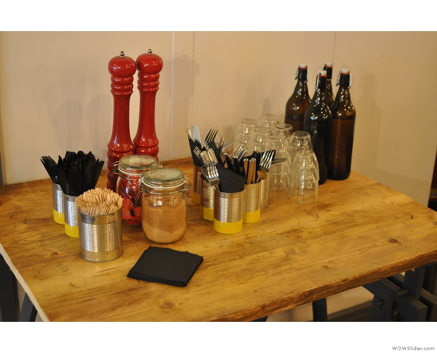 Condiments, cutlery and water, between the front and back seating areas.