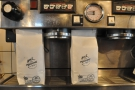 This may be the first time I've seen a La Marzocco espesso machine used as a coffee rack!