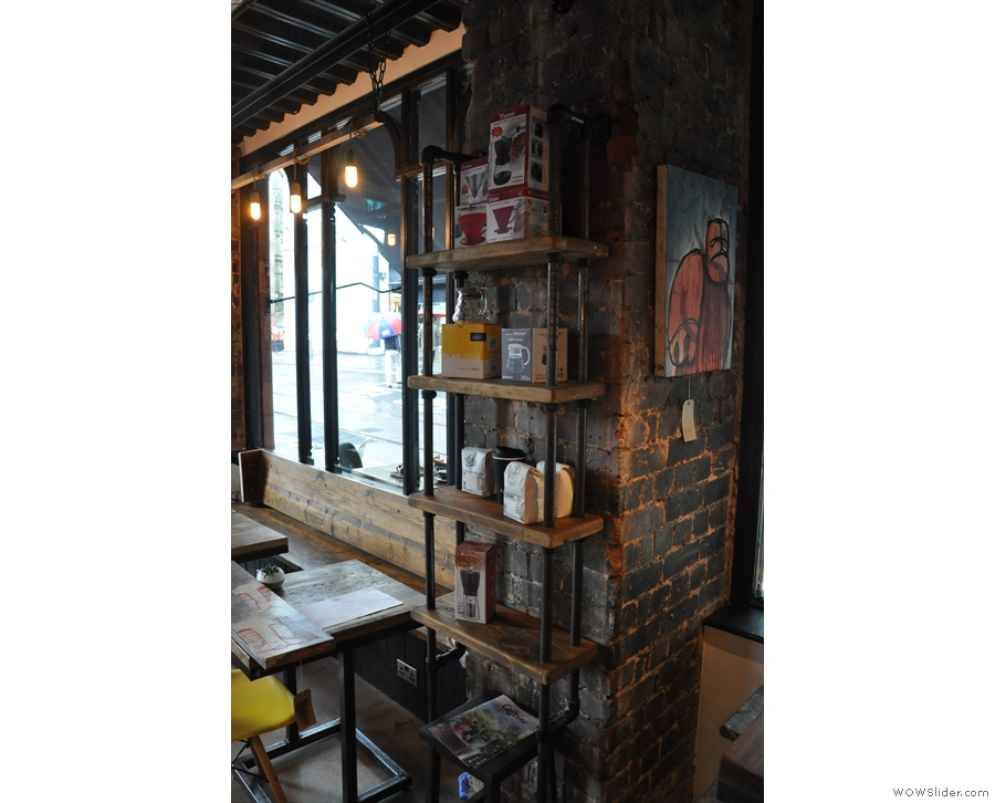 Some of the brick pillars between the windows are used as retail shelves...