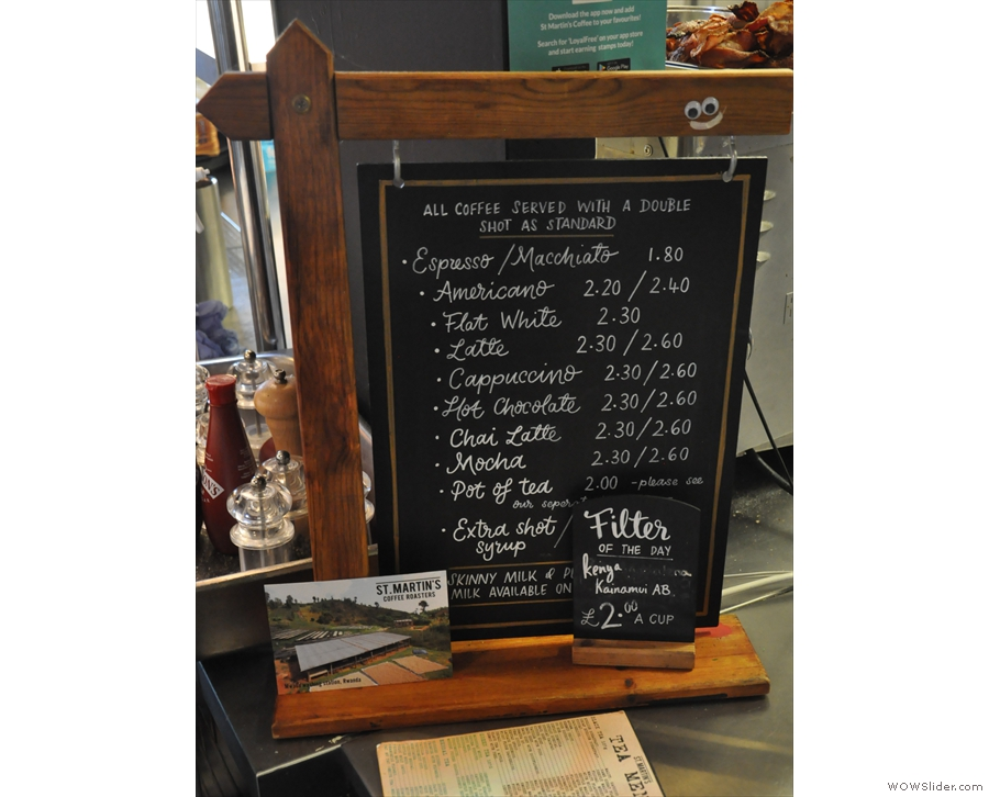The coffee menu and the day's filter option are on this chalkboard by the counter.