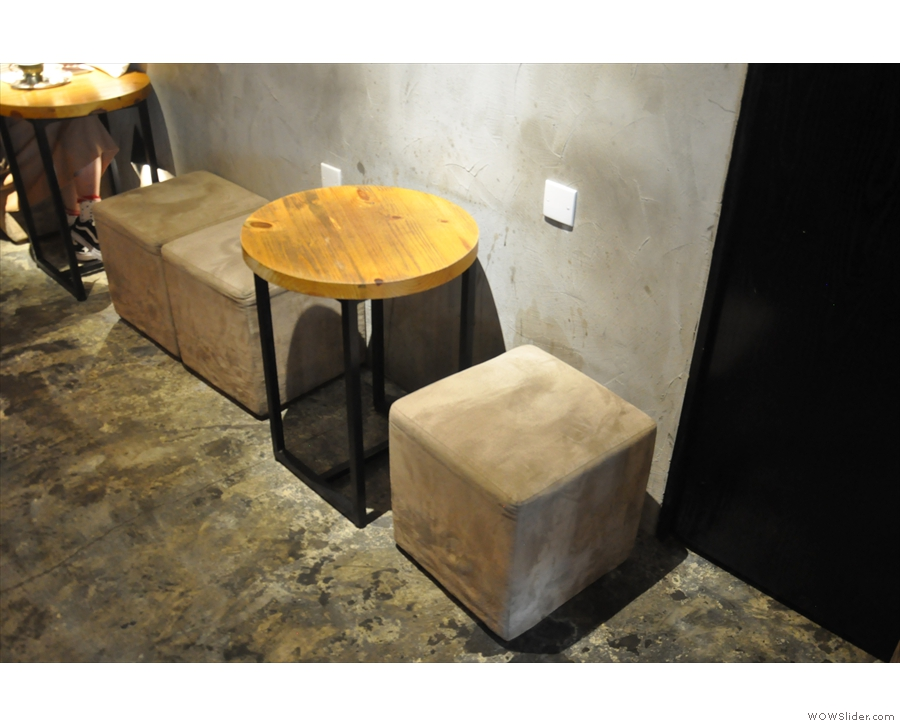 ... and round tables with square stools off to the right.