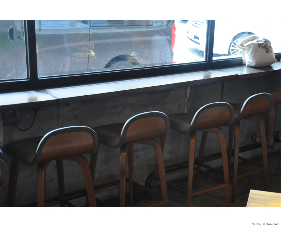 ... which has some comfortable-looking chairs and a view of the busy street.