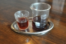 ... served in a small beaker with a glass on the side.