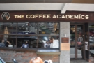 ... the Coffee Academics, with the door offset to the right, large windows to the left...
