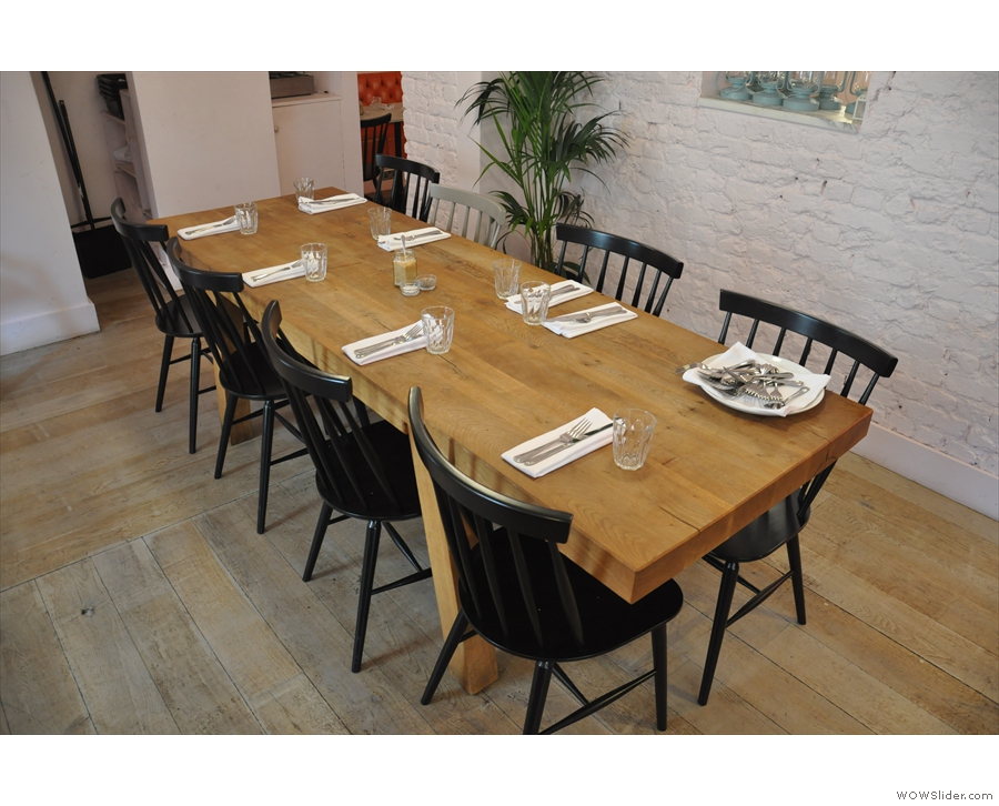 ... and this communal table on the right beyond the counter.