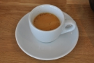 My espresso in its classic white cup.