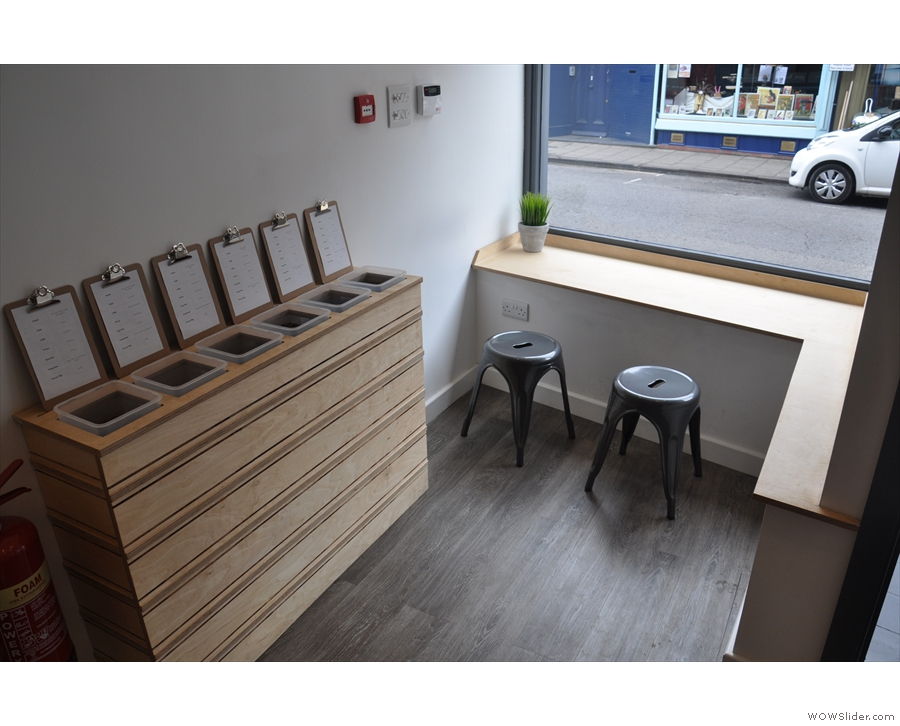 ... a deeply-recessed door creates seating areas on either side. However, Coffee + Beer...