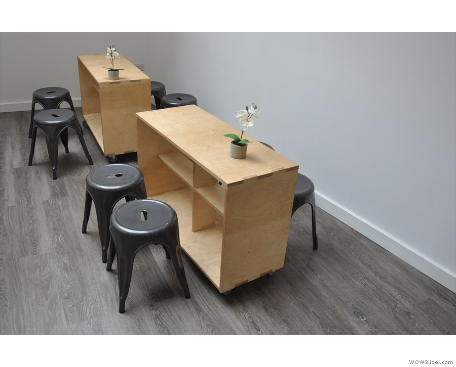 There are four of these interesting tables with low stools, two on each side.