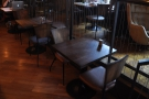 ... while on the other side, past the communal table, there are more conventional tables.