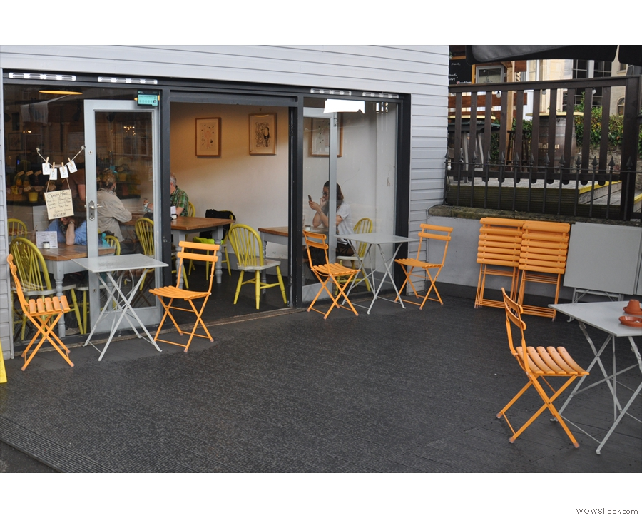 The actual coffee shop is at the back of the patio, where you'll find more tables.
