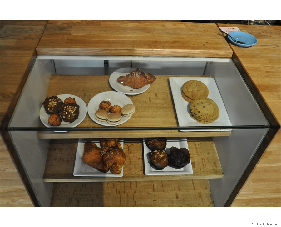 There are also cakes in an embdded glass display case in the centre of the counter.