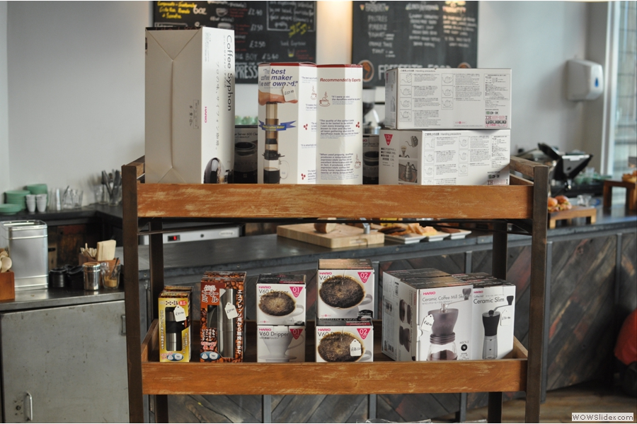 This shelf of coffee-making equipment also separates the main seating area from the counter.