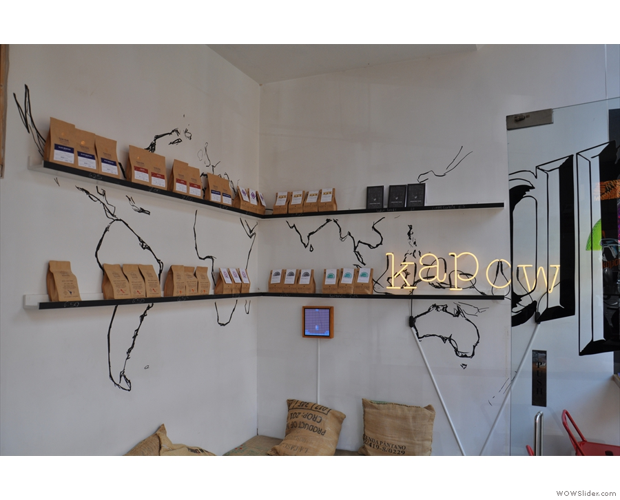 There are also plenty of bags of coffee for sale, arranged on the walls above the seat.