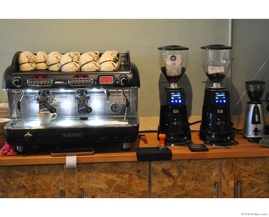 The espresso machine is on a separate workspace at the back of the counter...