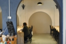 You enter by one of two arches. This one in the middle, by the counter...