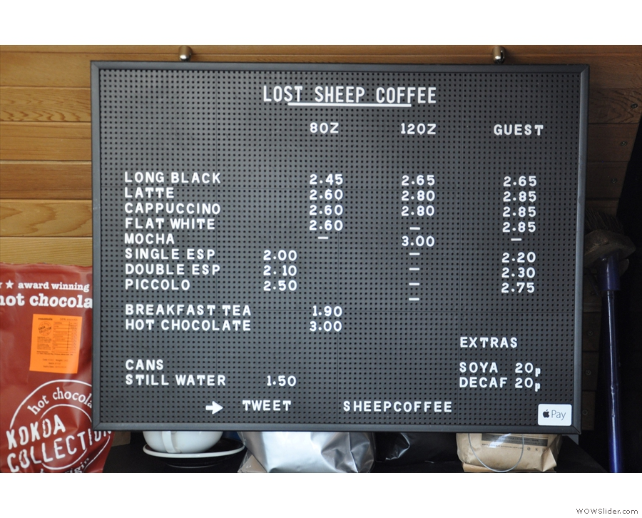 The concise, comprehensive coffee menu is on the back wall.