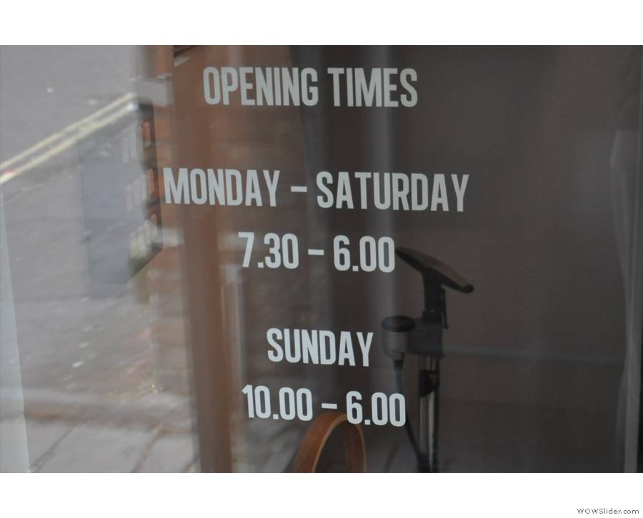 ... while the door handily has the opening times. Six o'clock on a Sunday? How civilised!
