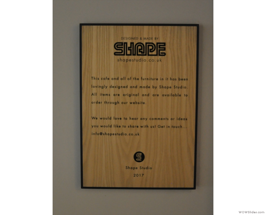 A plaque, dedicated to Shape Studio, which designed the cafe and its furniture.